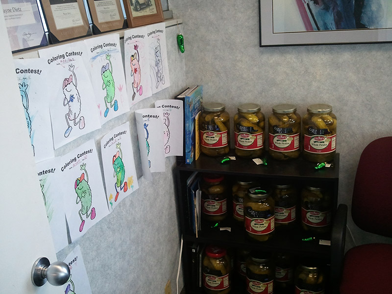 Photo of pickle jars and pictures.
